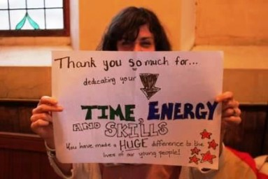 A Person Holding up a Thank You Sign To Volunteers