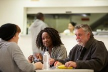 Stock Photo of Three People Eating in a Canteen